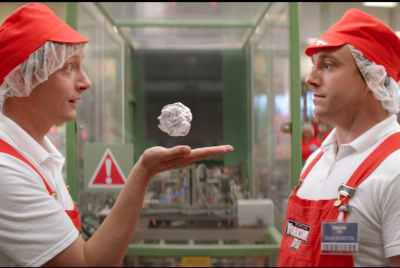 Still from the ad - 2 Yorkshire Tea employees with a floating litter ball